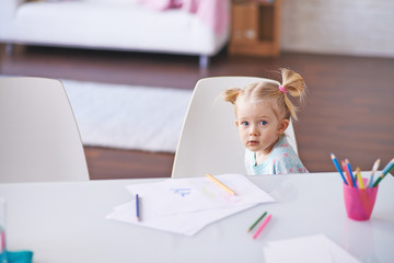 Little girl by desk