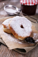 Delicious donuts with icing and powdered sugar