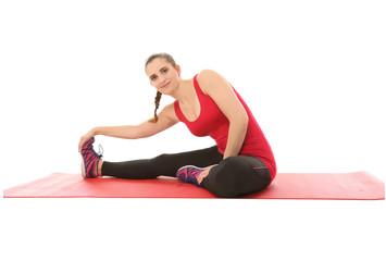 Junge Frau dehnt ihre Muskeln