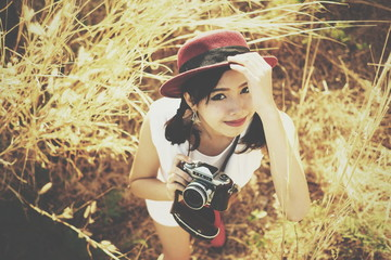 Asian girl with retro camera classic film