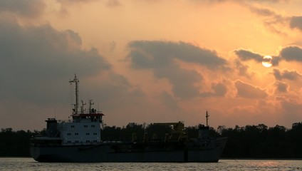 Cargo ship sails on sunset in Samutprakarn,Thailand