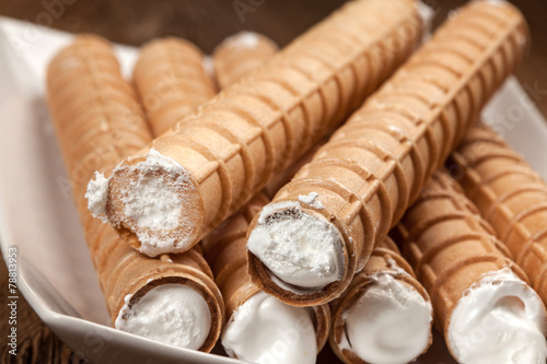 Sweet tube with whipped cream.