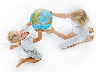 Kids play with world ball
