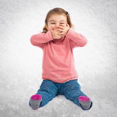 Little girl smiling over white background