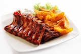 Grilled Pork Rib and Fried Potatoes on Plate