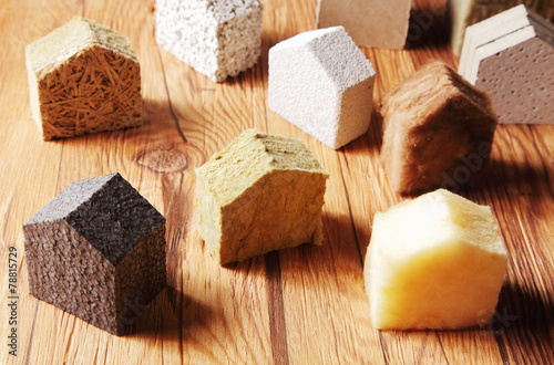 Scattered Blocks of insulation Model Hous on the Table - 78815729