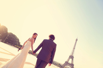 Bride and groom with Eiffel tower in background