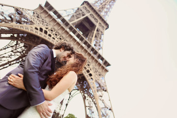 Bride and groom near Eiffel tower