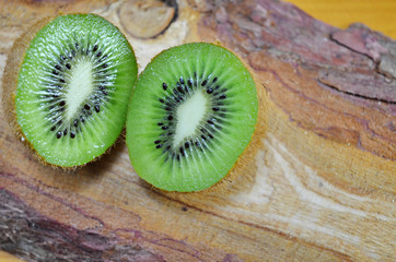 Halved kiwi on a wooden table