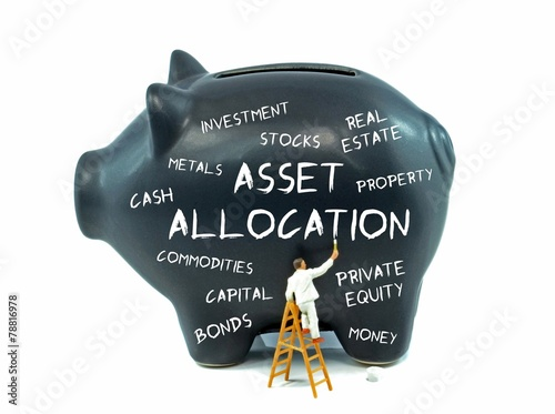 Leinwandbild Motiv Asset allocation theme piggy bank on a white background