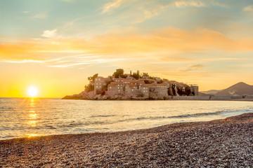 Sveti Stefan Island in Budva, Montenegro with a beautiful sunset