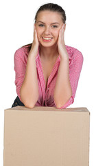 Woman resting her elbows on cardboard box