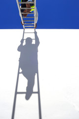 Thai man climbing on ladder for work
