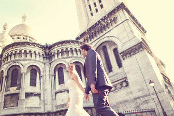 Bride and groom in front of a church