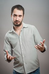 Businessman holding something in his hands on a gray background