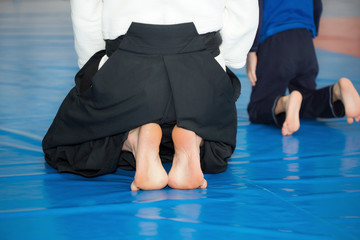 Aikido instructor sitting on tatami