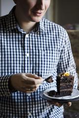 Man eating chocolate cake