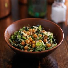 vegan caesar salad in wooden bowl
