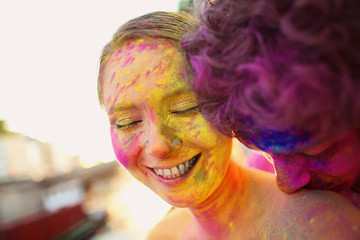 Lovers in Paris playing with holi powder