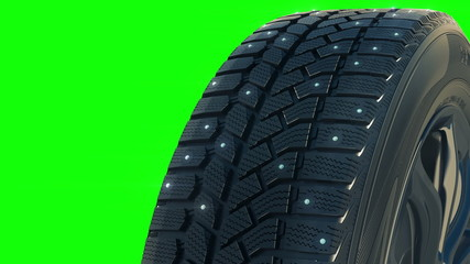 Car studded winter tyre wheel rotate on camera in motion