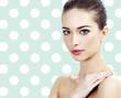 Pretty female against a polka dot background