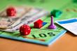 Leinwandbild Motiv Spiel um Geld