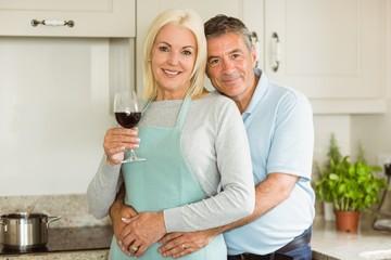 Happy mature couple smiling at camera