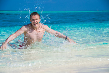 happy man in water with water splash,