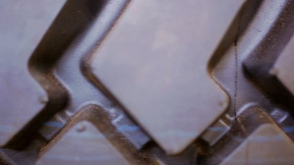 Close up of macro rubber tire tread. Video shift motion