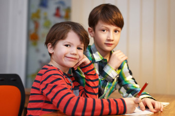 Little boys studying at home