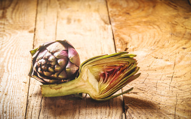 Fresh vegetables, artichoke on a wooden rustic background