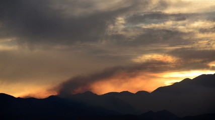 Time Lapse of Smoke from Forest Fire During Sunset