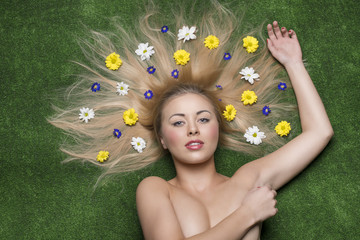 naked girl lying on meadow