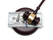 big wad of money and gavel closeup isolated on a white backgroun