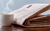 Newspaper and coffee mouse pad