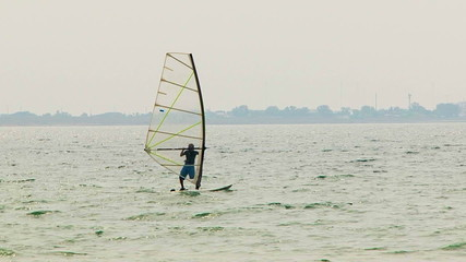 Windsurfer Slowly Sailing in the Sea