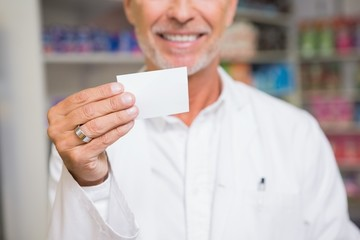 Senior pharmacist holding calling card