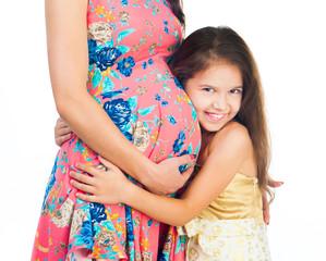 little girl hugging belly
