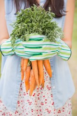 Woman holding her organic carrots