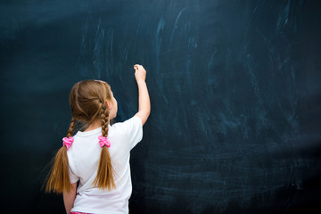 little girl against blackboard