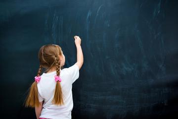 little girl against blackboard