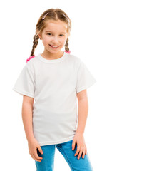 cute little girl in a white T-shirt and blue jeans