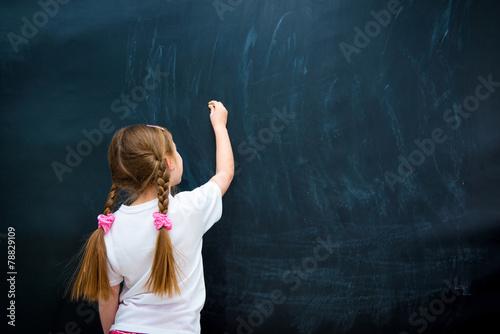 little girl against blackboard - 78829109