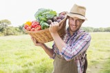 Farmer carrying basket of veg