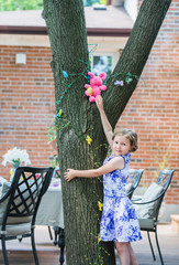 Girl Finds an Easter Egg Up in a Tree
