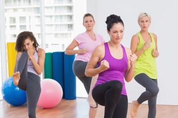 Women practicing kickboxing at fitness studio