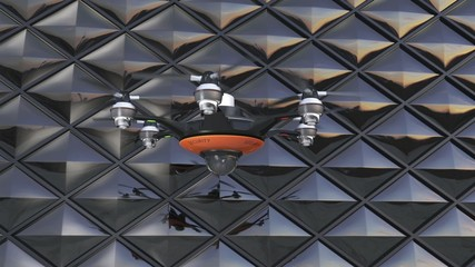 Drone with surveillance camera taking off  from a building