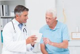 Doctor explaining prescription to senior patient