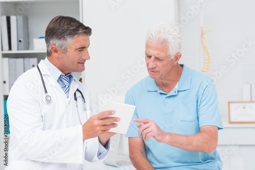 Leinwanddruck Bild Doctor explaining prescription to senior patient