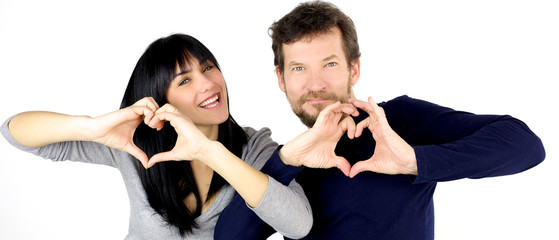 Happy couple showing love sign smiling isolated